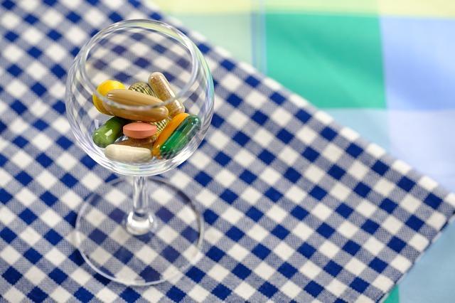 Vitamin E Deficiency Symptoms - A glass of vitamin capsules